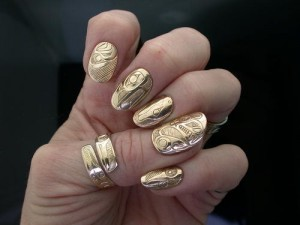 Gold nails and Chanel guns